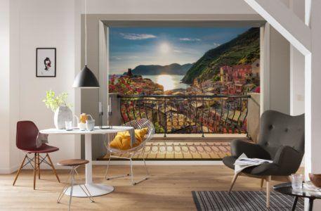 Оформление стены на кухне фотообоями с изображением открытого балкона и пейзажа
